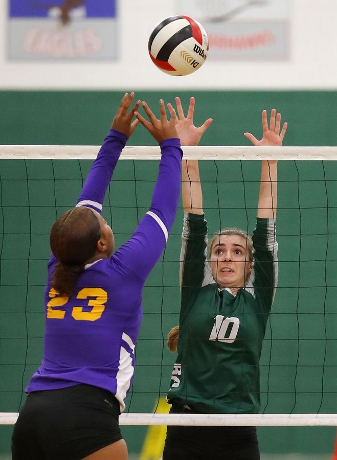 Grayslake Central's Sarah Chiappetta (10) and Waukegan's  Raven May meet at the net during their game Tuesday at Grayslake Central High School.