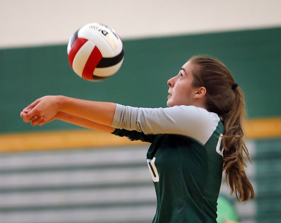 Grayslake Central's Sarah Chiappetta volleys during action against Waukegan Tuesday at Grayslake Central High School.