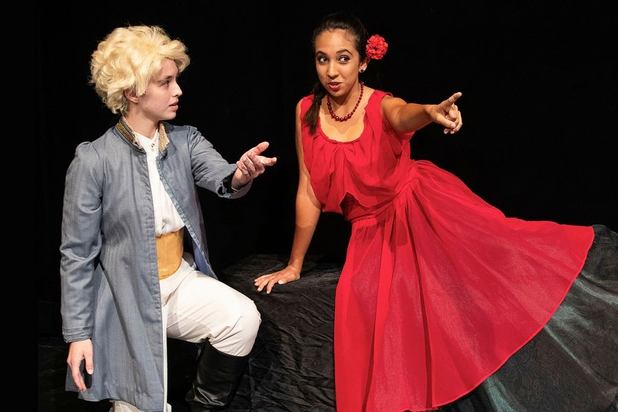 "Helen Murphy (the Little Prince) and Isabella Parra (the Rose) rehearse a scene from CLC Theatre's production of ""The Little Prince."""