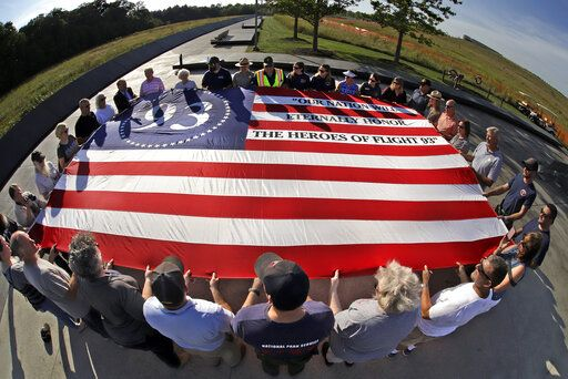 Visitors to the Flight 93 National Memorial in Shanksville, Pa., participate in a sunset memorial service on Tuesday, Sept. 10, 2019, as the nation prepares to mark the 18th anniversary of the Sept. 11, 2001 attacks.