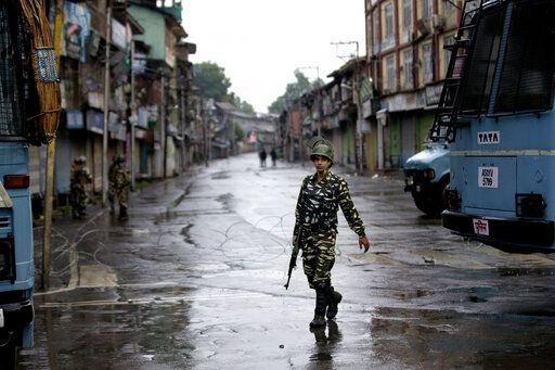 FILE - In this Wednesday, Aug. 14, 2019 file photo, an Indian paramilitary soldier patrols during security lockdown in Srinagar, Indian controlled Kashmir. Frustration, anger and fear have been growing in Kashmir in the five weeks since the Hindu nationalist government of Prime Minister Narendra Modi stripped the region of most of its semiautonomous status on Aug. 5 and imposed a curfew and a communications blackout. Although some restrictions have been eased in the main city of Srinagar, with students encouraged to return to school and businesses to reopen, rural residents complain of what they perceive as a campaign of violence and intimidation that seems designed at suppressing any militancy, rebellion or dissent.