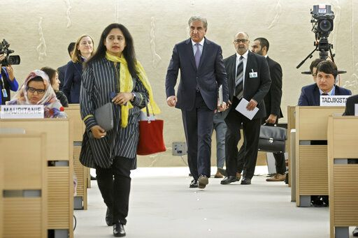 Pakistan's Foreign Minister Shah Mehmood Qureshi, center, arrives for a statement during the 42nd session of the Human Rights Council at the European headquarters of the United Nations in Geneva, Switzerland, Tuesday, Sept. 10, 2019. (Salvatore Di Nolfi/Keystone via AP)