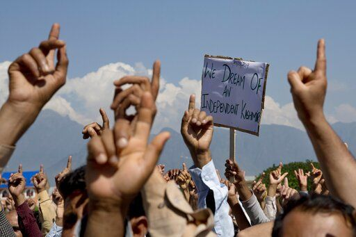 FILE - In this Friday, Aug. 23, 2019, file photo, Kashmiri men shout freedom slogans during a protest against New Delhi's tightened grip on the disputed region, after Friday prayers on the outskirts of Srinagar, Indian controlled Kashmir. Frustration, anger and fear have been growing in Kashmir in the five weeks since the Hindu nationalist government of Prime Minister Narendra Modi stripped the region of most of its semiautonomous status on Aug. 5 and imposed a curfew and a communications blackout. Although some restrictions have been eased in the main city of Srinagar, with students encouraged to return to school and businesses to reopen, rural residents complain of what they perceive as a campaign of violence and intimidation that seems designed at suppressing any militancy, rebellion or dissent.