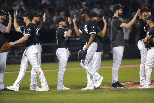 The Chicago White Sox celebrate the team's 7-3 win over the Kansas City Royals in a baseball game Tuesday, Sept. 10, 2019, in Chicago.
