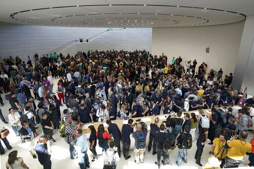 Event attendees get a look at the new products at the Steve Jobs Theater during an event to announcement Tuesday, Sept. 10, 2019, in Cupertino, Calif.