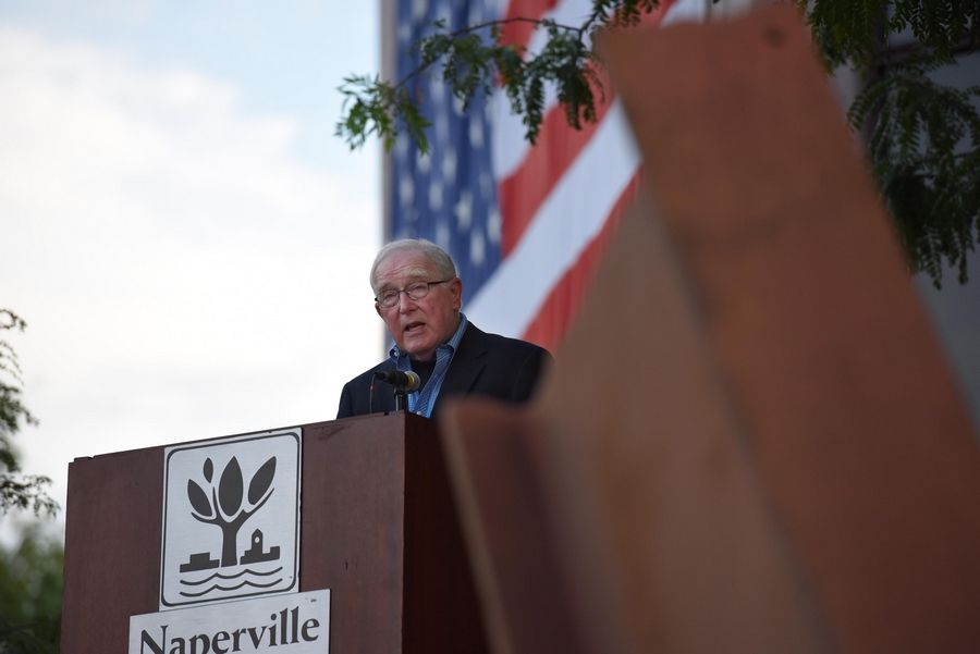 Charles F. Johanns, co-chairman of the Cmdr. Dan Shanower/Sept. 11 Memorial Commission in Naperville speaks Wednesday at the city's remembrance ceremony about how the memorial came together.
