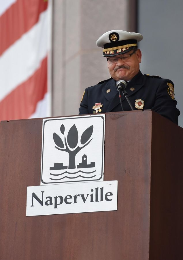 Mark Puknaitis, Naperville fire chief, catches his breath Wednesday during the Sept. 11 remembrance ceremony at the Cmdr. Dan Shanower/Sept. 11 Memorial along the Riverwalk at the municipal center.