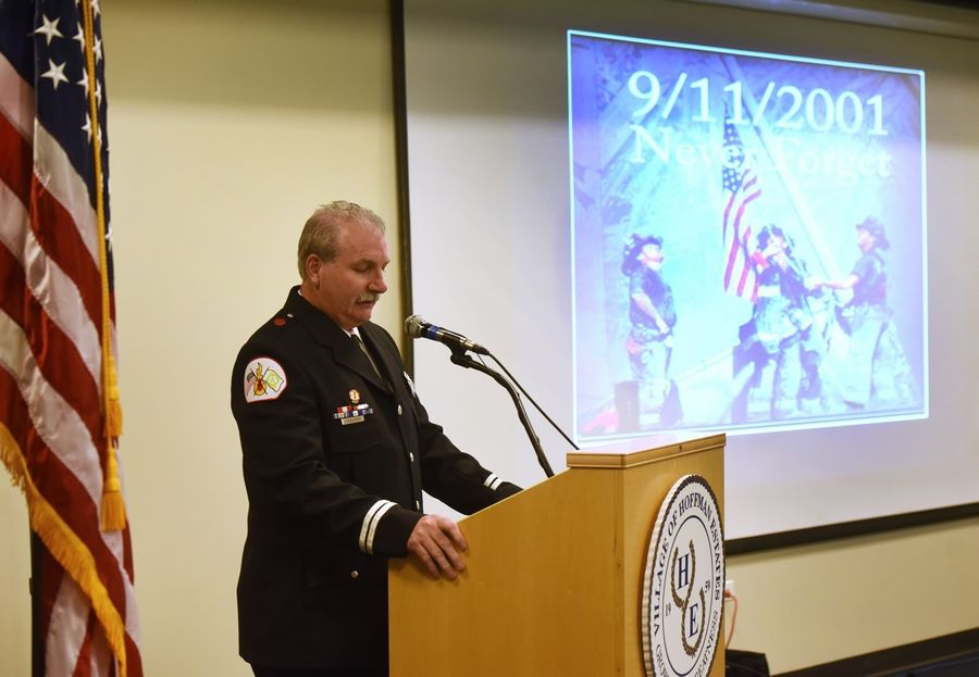 Schaumburg fire Capt. John Schneidwind, who was among the long-distance responders after Sept. 11, speaks during a Sept. 11 remembrance ceremony Wednesday at the Hoffman Estates village hall.