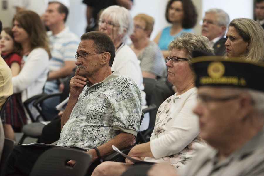 Audience members listen to the keynote speaker, Schaumburg fire Capt. John Schneidwind, who was among the long-distance responders after Sept. 11, during a Sept. 11 remembrance ceremony Wednesday at the Hoffman Estates village hall.