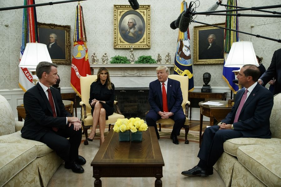 President Donald Trump talks Wednesday about a plan to ban most flavored e-cigarettes. From left, acting FDA Commissioner Ned Sharpless, first lady Melania Trump, Trump, and Secretary of Health and Human Services Alex Azar.
