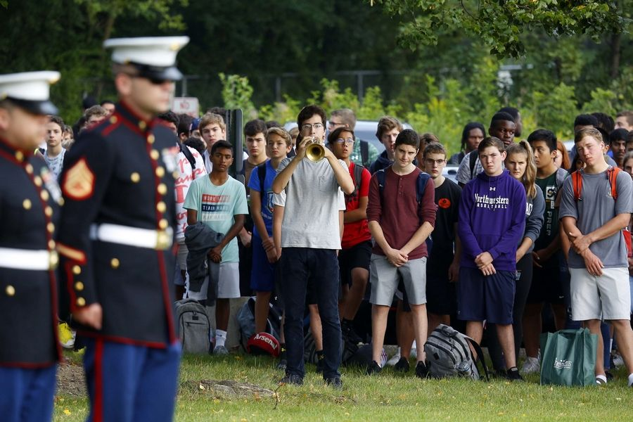 "Stevenson High School senior John Raymond plays ""Taps"" during a Sept. 11 remembrance ceremony outside the Lincolnshire school Wednesday. About 200 Stevenson students, faculty and staff joined local first responders and others at the event."
