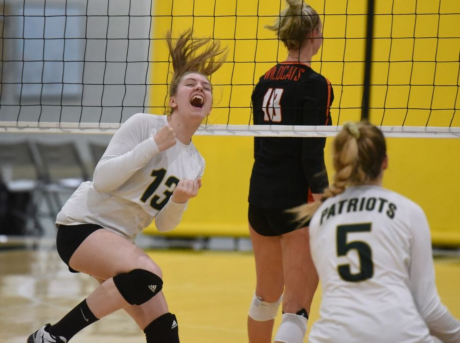 Stevenson's Emma Potocki (13) celebrates the Patriots' first-set victory over Libertyville during Wednesday night's volleyball match in Lincolnshire.