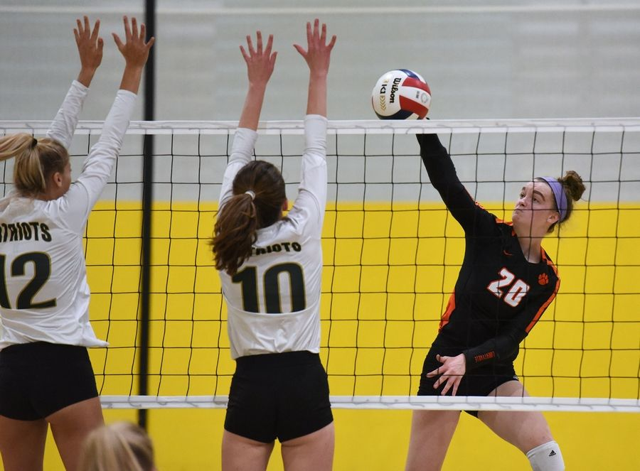 Libertyville's Kellie Hopper (20) tries to find a hole past Stevenson's Aimee Steammer (12) and Olivia Barreca (10) during Wednesday night's match in Lincolnshire.