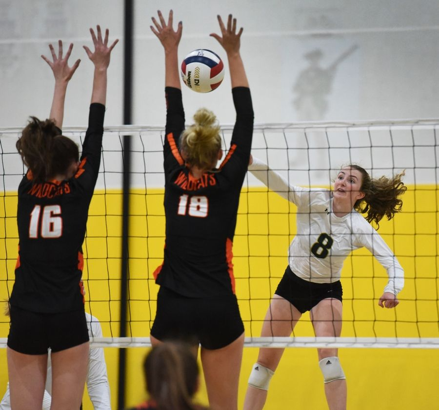Stevenson's Amanda Holsen (8) knocks the ball past Libertyville's Kaylie Stuteville (16) and Peyton O'Brien (18) during Wednesday night's volleyball match in Lincolnshire.