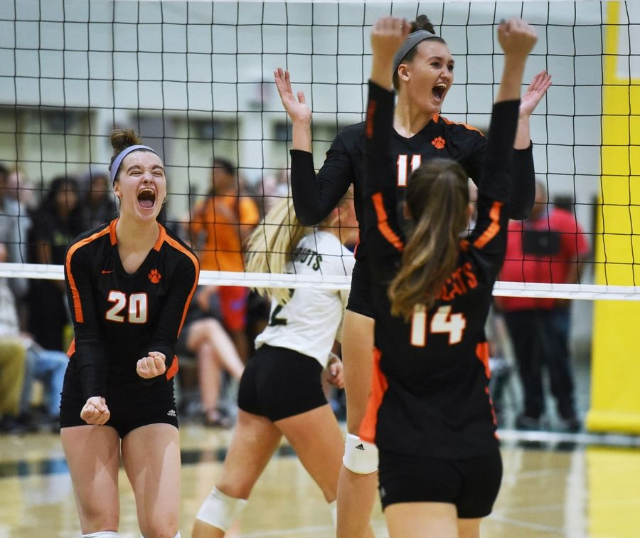Libertyville's Kellie Hopper (20) and Cassidy Jones (11) celebrate a point to tie the score against Stevenson during Wednesday night's volleyball match in Lincolnshire.