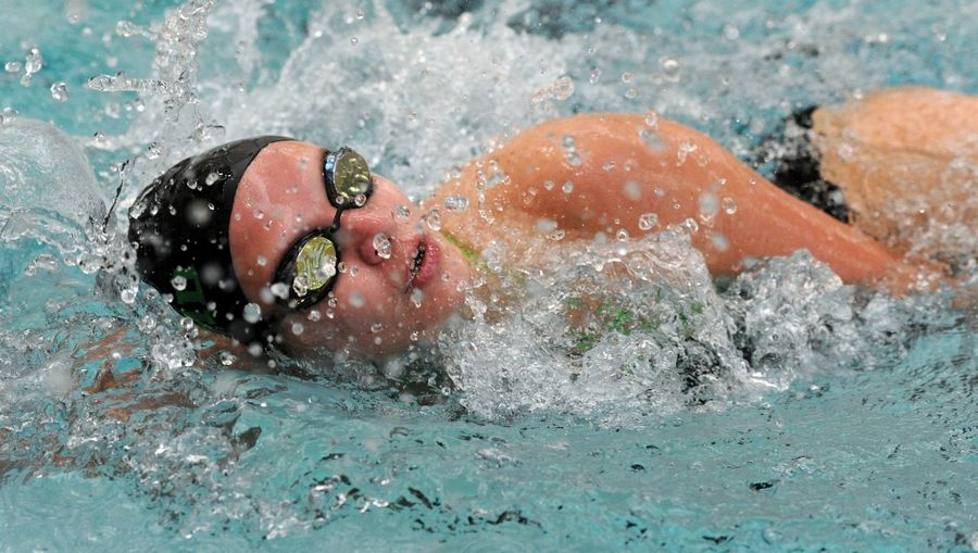 Mark Welsh/mwelsh@dailyherald.comFremd's Adrianna Buzuloiu wins first place in the varsity 200 yard IM against Hersey in girls swimming at Prospect High School on Thursday.