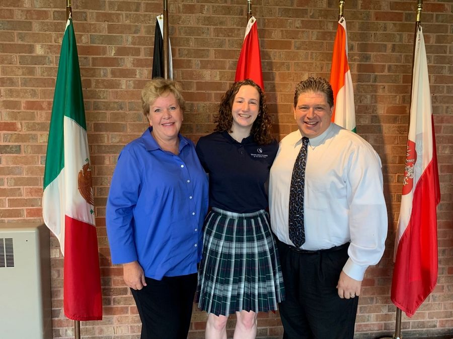 Woodlands Academy senior Elizabeth Coughlin, of Northbrook, is shown with Associate Head for Academics & Student Life Christine Schmidt and Principal Rocco Gargiulo after learning she's a 2020 National Merit Scholarship semi-finalist.Woodlands Academy