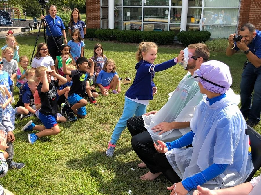 An Oak Grove student puts a pie in the face of social emotional/behavior coordinator Ryan Murray.