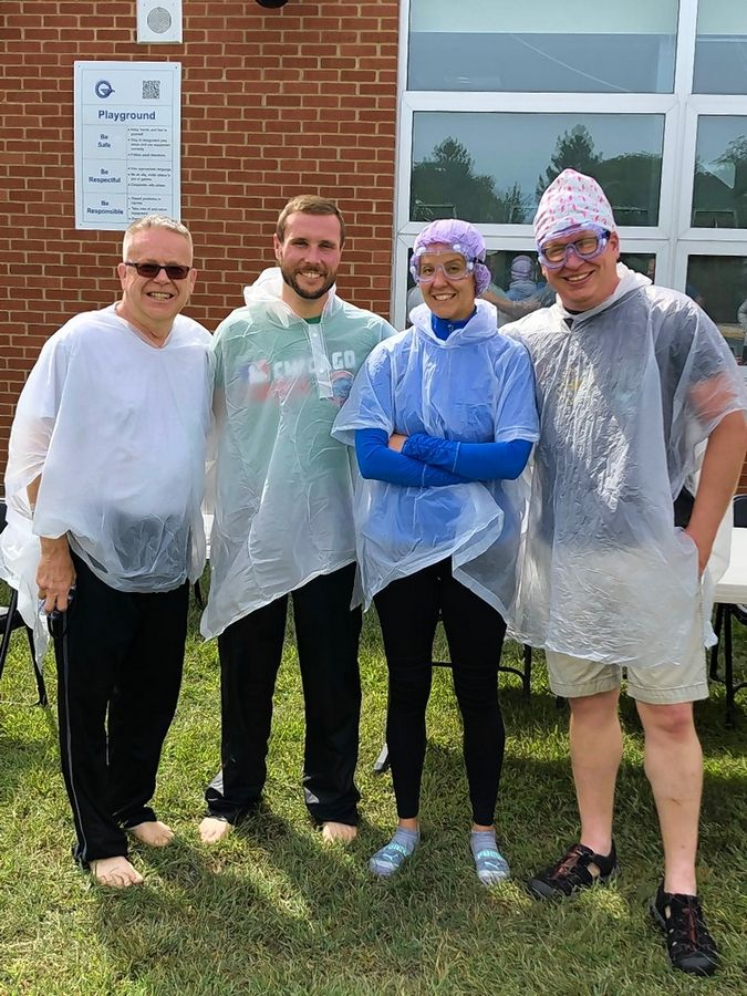 Superintendent Dr. Lonny Lemon, social emotional/behavior coordinator Ryan Murray, Assistant Principal Lilli Melamed and Principal Nick Heckel. Each student at Oak Grove School in Libertyville who met their goals in the Summer Reading Challenge program had an opportunity to throw a pie in the face of one of the four administrators.