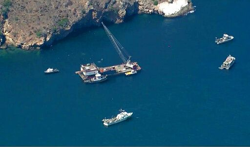 This photo from video provided by KABC-TV shows divers resuming their search Wednesday, Sept. 11, 2019 for the final missing victim who perished in a boat fire off the Southern California coast. The victim is one of 34 who died at sea last week near Santa Cruz Island when the dive boat Conception burned and sank on Sept. 2. Santa Barbara County Sheriff's Lt. Erik Raney says salvage efforts to recover the Conception also resumed Wednesday. (KABC-TV via AP)