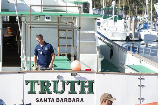 "FBI agents search the Truth dive boat, a sister vessel to the Conception, as authorities issue a search warrant for the Truth Aquatics' offices on the Santa Barbara Harbor in Santa Barbara, Calif., Sunday, Sept. 8, 2019. The office was ringed in red ""crime scene"" tape as more than a dozen agents took photos and carried out boxes. Thirty-four people died when the Conception burned and sank before dawn on Sept. 2. They were sleeping in a cramped bunkroom below the main deck and their escape routes were blocked by fire."