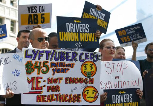 Dozens of supporters of a measure to limit when companies can label workers as independent contractors rally at the Capitol in Sacramento, Calif., Wednesday, Aug. 28, 2019. If approved by the legislature and signed by Gov. Gavin Newsom, AB5, by Assemblywoman Lorena Gonzalez, D-San Diego, would require companies like Uber and Lyft to treat their drivers like employees.