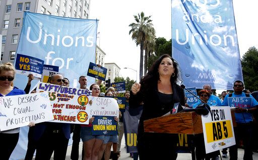 Assemblywoman Lorena Gonzalez, D-San Diego, speaks at rally calling for passage of her measure to limit when companies can label workers as independent contractors at the Capitol in Sacramento, Calif., Wednesday, Aug. 28, 2019. If approved by the legislature and signed by Gov. Gavin Newsom, AB5, would require companies like Uber and Lyft to treat their drivers like employees.