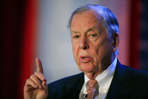 FILE - In this June 15, 2009, file photo, T. Boone Pickens, president of BP Capital Group, speaks at Time Warner's headquarters in New York. Pickens, a brash and quotable oil tycoon who grew even wealthier through corporate takeover attempts, died Wednesday, Sept. 11, 2019. He was 91.