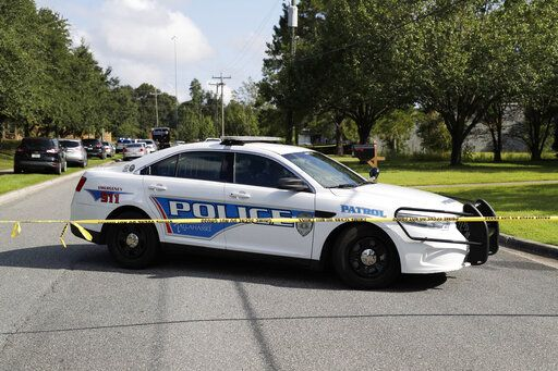 Tallahassee police investigate the scene of multiple stabbings, Wednesday, Sept. 11, 2019 in Tallahassee, Fla. A suspect stabbed at least five people at a building supply company in Florida's capital city before being taken into custody by police officers, authorities said. (Tori Schneider/Tallahassee Democrat via AP)