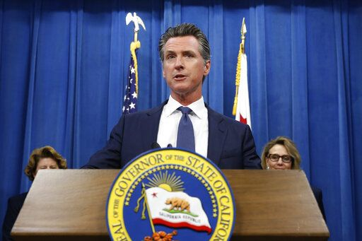 FILE - In this July 23, 2019, file photo, California Gov. Gavin Newsom speaks at a news conference in Sacramento, Calif. The NCAA's Board of Governors is urging Gov. Gavin Newsom not to sign a California bill that would allow college athletes to receive money for their names, likenesses or images. In a six-paragraph letter to Newsom, the board said the bill would give California schools an unfair recruiting advantage. As a result, the letter says, the NCAA would declare those schools ineligible for its events.