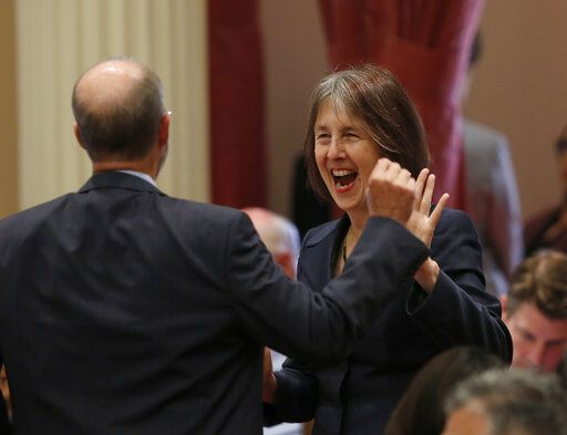 "Sen. Nancy Skinner, D-Berkeley, celebrates with Sen. Steven Glazer, D-Orinda, after her measure to let athletes at California colleges hire agents and sign endorsement deals was approved by the Senate in Sacramento, Calif., Wednesday, Sept. 11, 2019. The bill now goes to Gov. Gavin Newsom, who has not said whether he will sign it. But the NCAA Board Of Governors is already urging him not to, sending him a letter Wednesday saying the bill ""would erase the critical distinction between college and professional athletics"" and would have drastic consequences for California's colleges and universities."