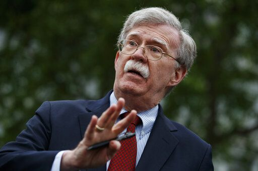 FILE - In this May 1, 2019 file photo, National security adviser John Bolton talks to reporters outside the White House in Washington. Trump says he fired national security adviser John Bolton, says they 'disagreed strongly' on many issues.