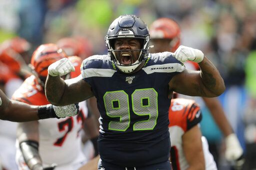 Seattle Seahawks defensive tackle Quinton Jefferson (99) reacts after he sacked Cincinnati Bengals quarterback Andy Dalton during the second half of an NFL football game Sunday, Sept. 8, 2019, in Seattle.