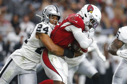FILE - In this Thursday, Aug. 15, 2019 file photo, Oakland Raiders defensive back Johnathan Abram (24) tackles Arizona Cardinals running back David Johnson (31) during the first half of an an NFL football game in Glendale, Ariz. Oakland Raiders rookie safety Johnathan Abram will be placed on injured reserve after injuring his shoulder in the season opener. Abram injured himself in the first half Monday night, Sept. 9, 2019 against the Denver Broncos.