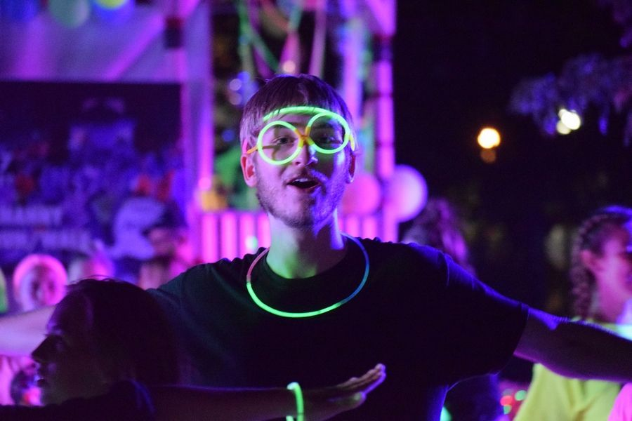 Huntley High School student Logan Blake enjoys the dance party on the Square following the Huntley Hootenanny GLOW 5K Saturday, Sept. 7.