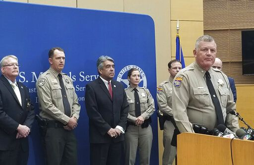 Arizona Department of Public Safety Col. Frank Milstead speaks at a news conference Thursday, Sept. 12, 2019 at the Sandra Day O'Connor Federal Courthouse in Phoenix about the capture of husband and wife fugitives. Blane and Susan Barksdale, who have been on the run for over two weeks, were taken into custody Wednesday in a rural community about 50 miles (80 kilometers) northeast of Phoenix.