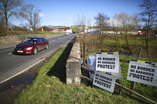 FILE - In this March 12, 2019, file photo, a motorist crosses the Irish border in Middletown, Northern Ireland. With Brexit due on Oct. 31, 2019 and a costly no-deal a possible outcome, experts still do not know, or are reluctant to say, exactly what checks are likely at the Irish border. Nevertheless, British Prime Minister Boris Johnson remains convinced that a Brexit deal can be sealed with the EU in a few weeks.