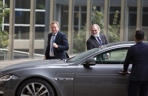 United Kingdom's Brexit advisor David Frost, left, and British Ambassador to the EU Tim Barrow, center, arrive at EU headquarters for a technical meeting on Brexit in Brussels, Wednesday, Sept. 11, 2019.