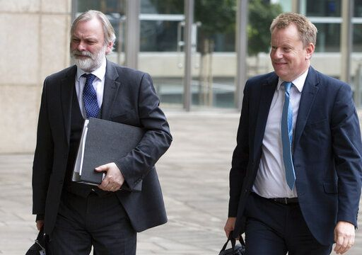 United Kingdom's Brexit advisor David Frost, right, and British Ambassador to the EU Tim Barrow arrive at EU headquarters for a technical meeting on Brexit in Brussels, Wednesday, Sept. 11, 2019.