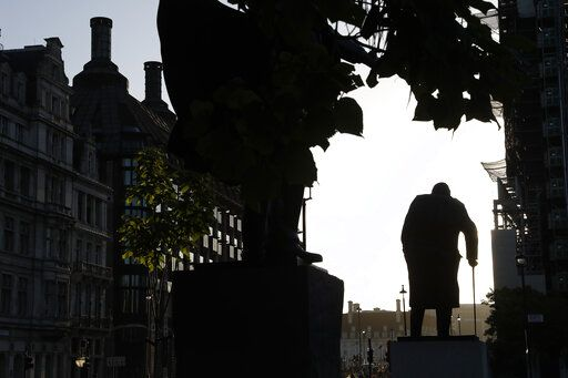 The statue of former British Prime Minister Winston Churchill is silhouetted against the sky early morning in London, Thursday, Sept. 12, 2019.