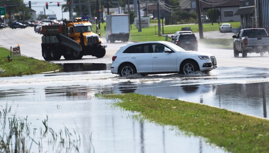 Water covers Washington Street east of Gurnee and Route 41 Friday morning following heavy overnight rain.