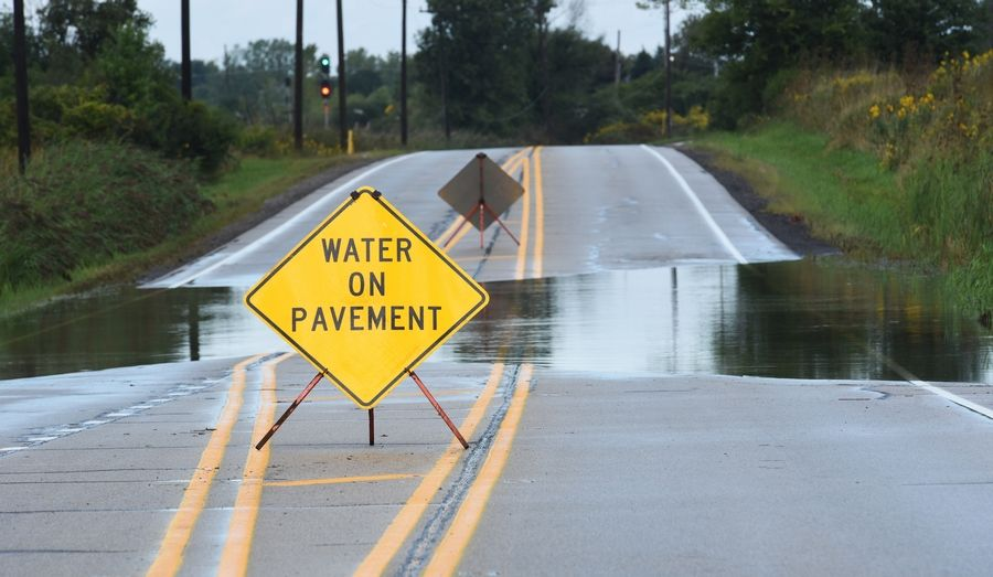 Casey Road west of Midlothian Road in Grayslake was closed Friday morning after overnight rains impacted many Lake County roads.