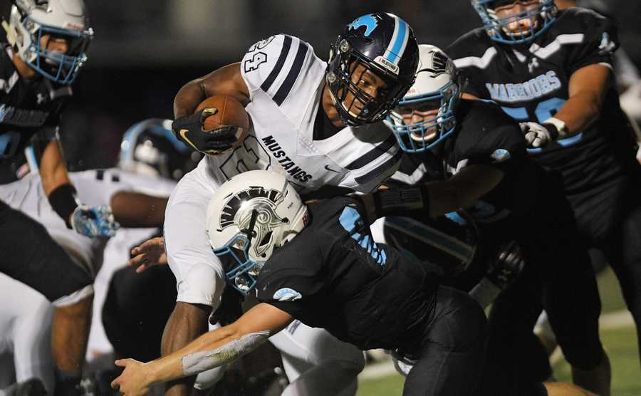 Downers Grove South's Rahshon Murff is stopped short of the goal line by Willowbrook's Sam Tumilty.