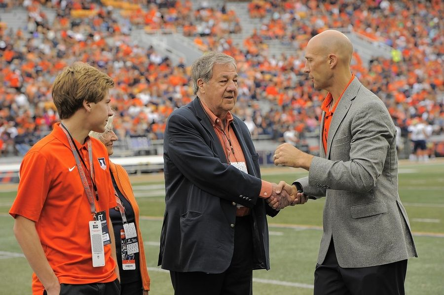 Dennis Swanson and his wife, Kathy, are thanked before Illinois' Aug. 31 football game by athletic director Josh Whitman for their donation to the university's basketball programs. Grandson Derek Swanson, an undergrad, took part in the ceremony.