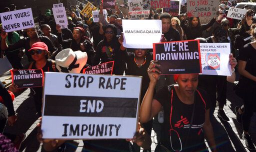 Demonstrators hold up banners in Sandton, Johannesburg, Friday Sept. 13, 2019, as they protest against gender-based violence. The protesters are calling on President Cyril Ramaphosa to declare a state of emergency a day after the country's latest crime statistics were released.