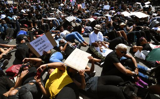 Demonstrators protest against gender based violence in Sandton, Johannesburg Friday, Sept. 13, 2019. The protesters are calling on President Cyril Ramaphosa to declare a state of emergency, a day after the country's latest crime statistics were released.