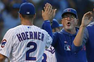 Chicago Cubs' Nico Hoerner (2) celebrates with manager Joe Maddon right, after defeating the Pittsburgh Pirates in a baseball game Friday, Sept. 13, 2019, in Chicago. (AP Photo/Paul Beaty)