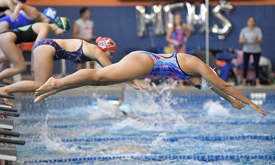 Hoffman Estates' Amy Lam starts the second leg of the 200 yard medley relay at the Hoffman Estates girls swim invitational Saturday.