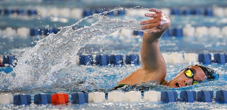 Elk Grove's Anja Restak competes in the 200-yard freestyle at the Hoffman Estates girls swim invitational Saturday.