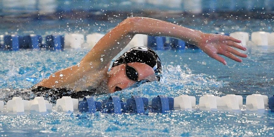 Elgin's Tessa Halleen competes in the 200-yard freestyle at the Hoffman Estates girls swim invitational Saturday.